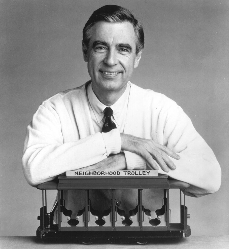Fred Rogers poses with his show's neighborhood trolley