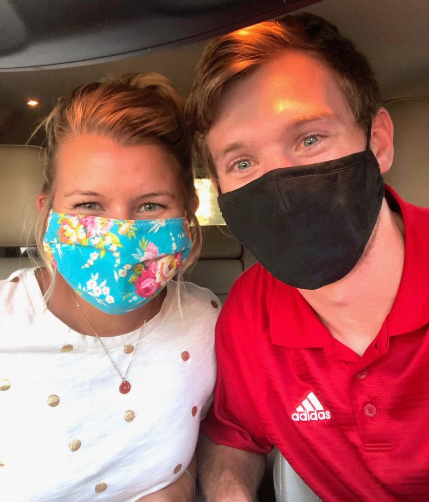Torrie Sheridan pictured with her husband in COVID-19 masks