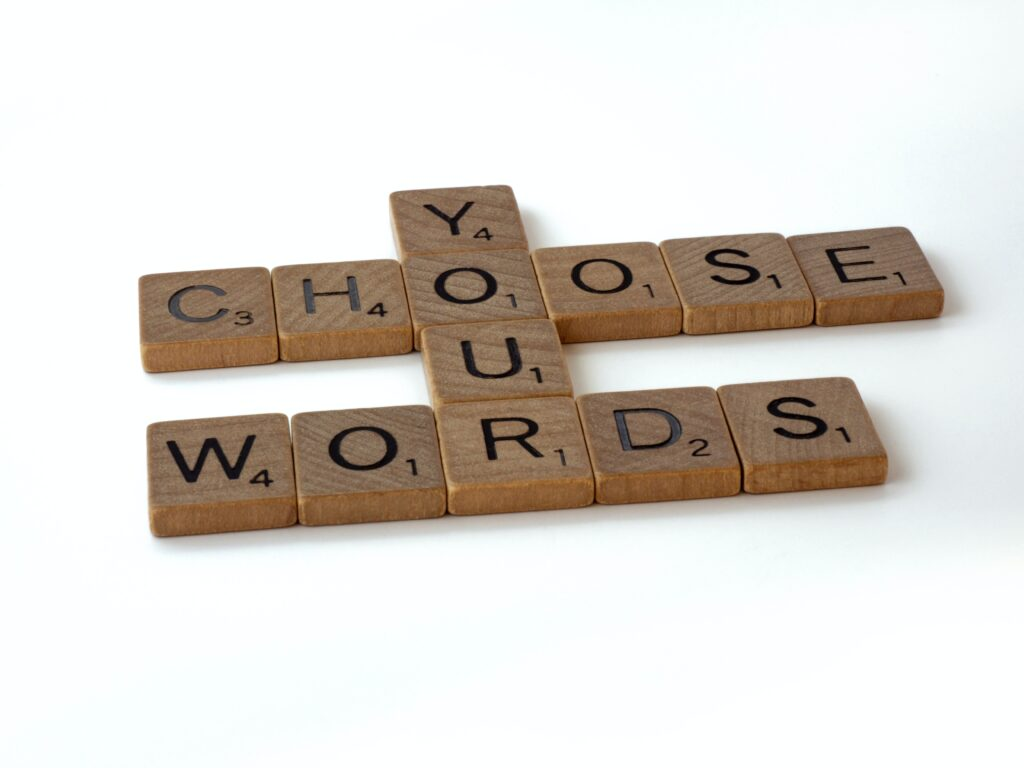 Scrabble tiles spelling out Choose Your Words