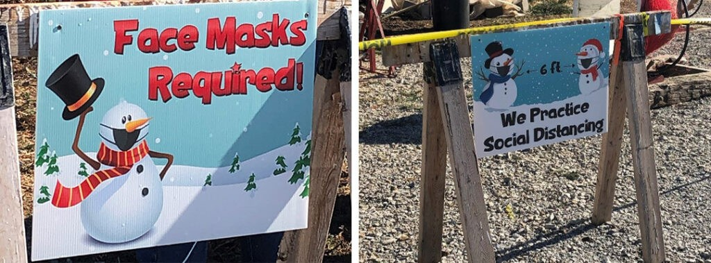 social distancing and face mask required sign seen at a Christmas tree farm