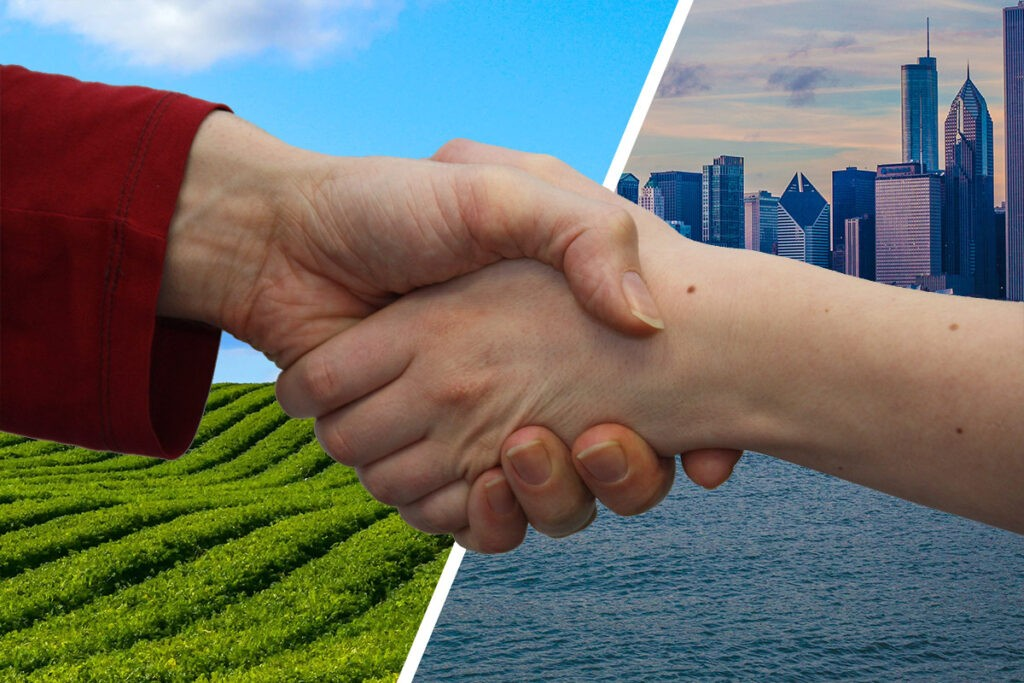 a handshake superimposed over a split screen of rural and city backgrounds